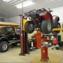 System I lifting an ATV