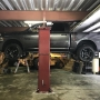Mohawk vehicle lift shown installed with low ceiling